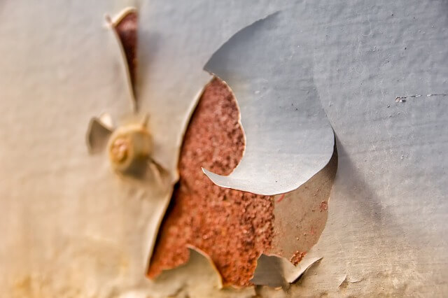 Painting over flaking paint